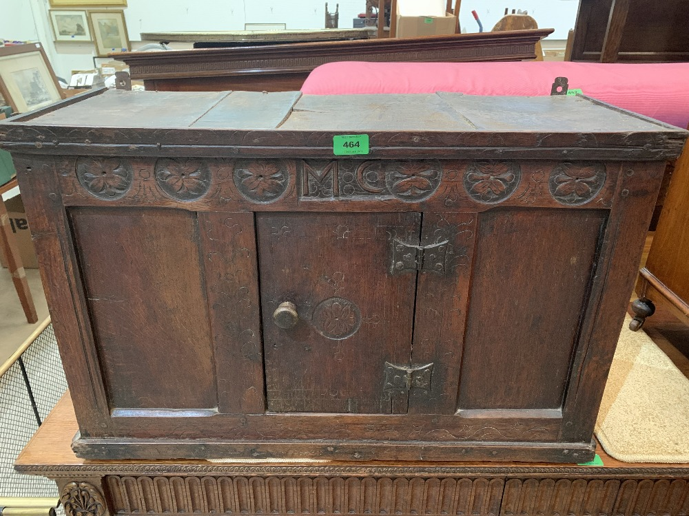 A mid 17th century joined oak mural dole cupboard, with carving in period of paterae and scratched