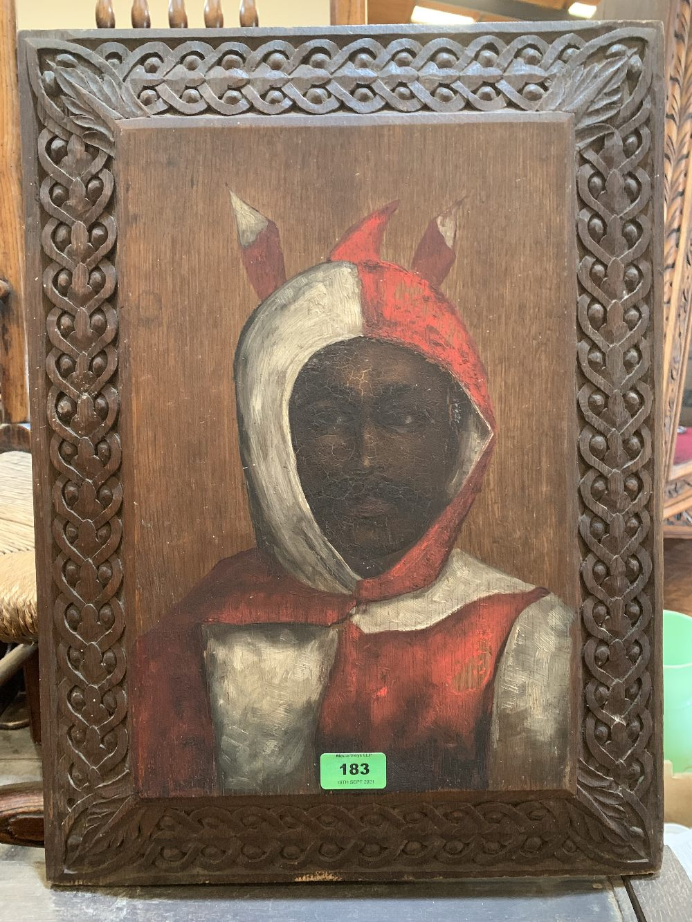 A scratch carved and painted wood panel of a girl with sheep and a painting on wood panel of a