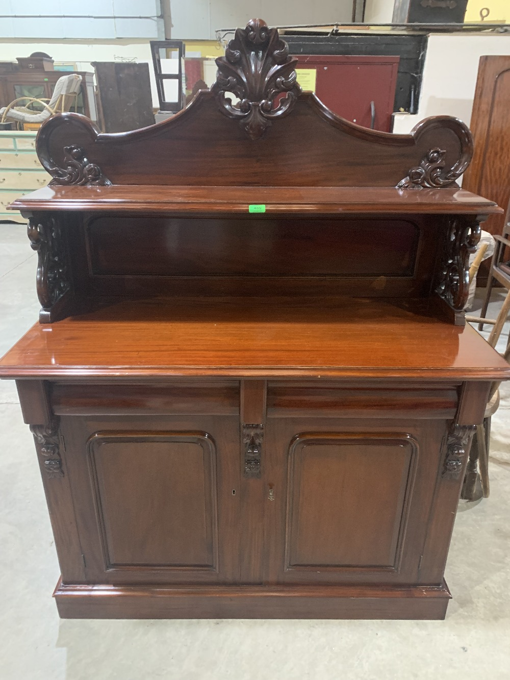 A mahogany chiffonier with raised back over a pair of frieze drawers and conforming cupboard