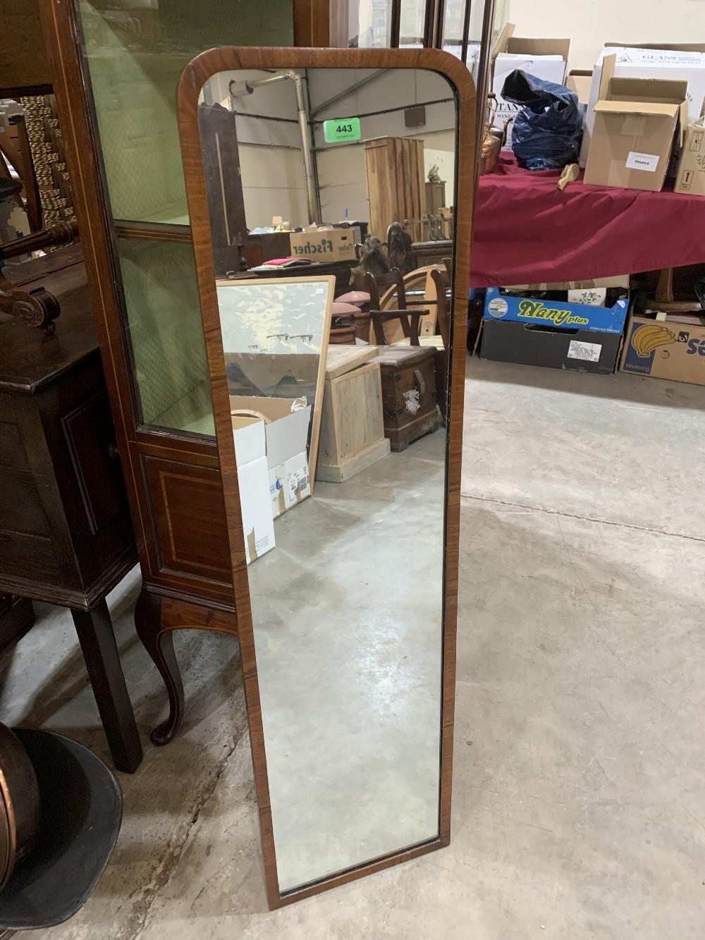 A walnut framed looking glass. 49' high