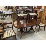 A Regency style drawleaf dining table and six sabre legged chairs