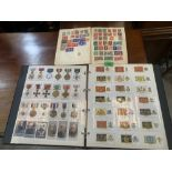 A folder and two old albums of mostly Military cigarette card medals. Regimental colours ships