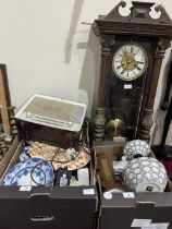 Two boxes of china, a Vienna clock and a vintage wireless