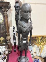 Three carved treen ethnic figures