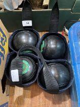 A set of four lawn bowls