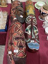 Five carved treen ethnic masks