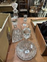A ship's decanter, another cut glass decanter and two plain examples