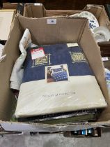 A box of curtains and linen