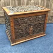 A 20TH CENTURY CARVED OAK LOG BOX