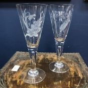 A SET OF EIGHT ETCHED CHAMPAGNE GLASSES