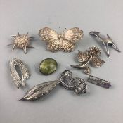 A LOT OF NINE SILVER BROOCHES