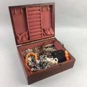 A LOT OF VARIOUS COSTUME JEWELLERY CONTAINED IN A JEWELLERY BOX