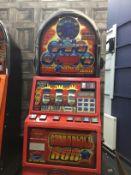 A CASINO MODEL, DOMED TOP 'CANNONBALL RUN £5 JACKPOT FRUIT MACHINE