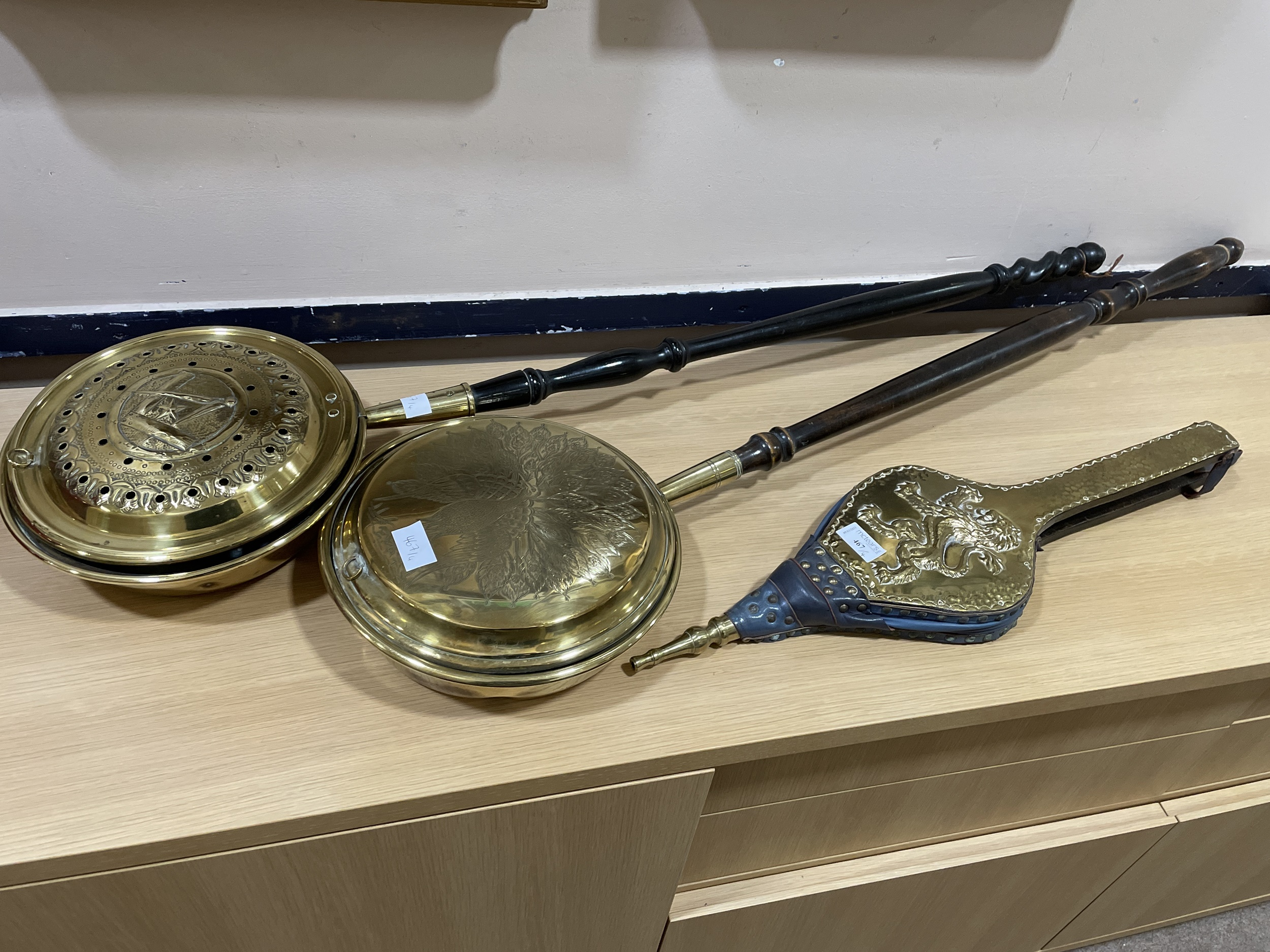 A PAIR OF VINTAGE BELLOWS, TWO BRASS BED PANS AND A BRASS CHARGER