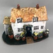 A STUDIO POTTERY FIGURE OF A COTTAGE AND OTHER CERAMICS