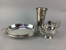 A SILVER PLATED CIRCULAR TRAY AND OTHER PLATE