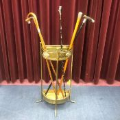 A BRASS SEMI CIRCULAR STICK STAND AND VARIOUS STICKS AND CANES