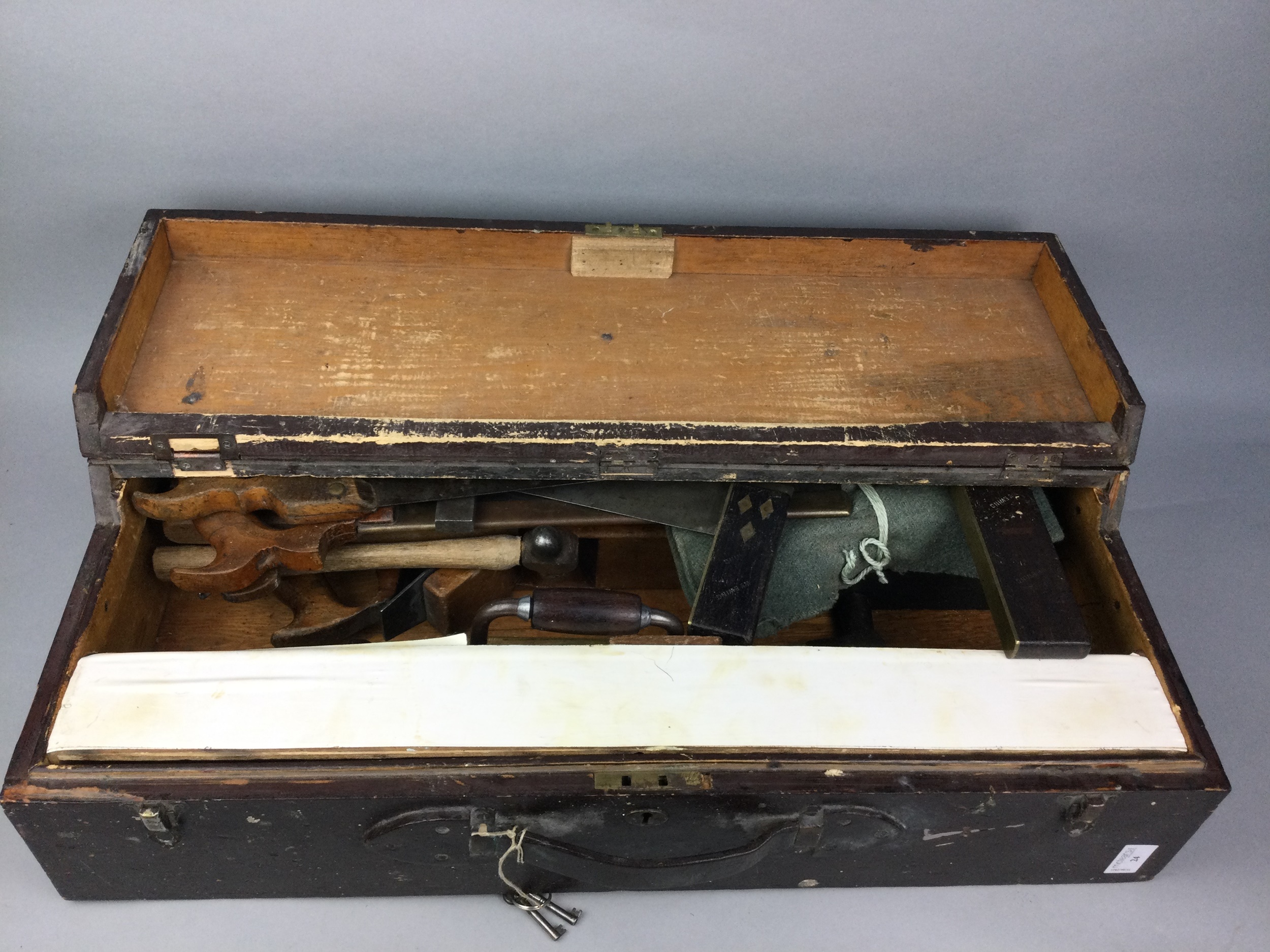 A TOOL BOX CONTAINING A GOOD SELECTION OF EARLY 20TH CENTURY TOOLS