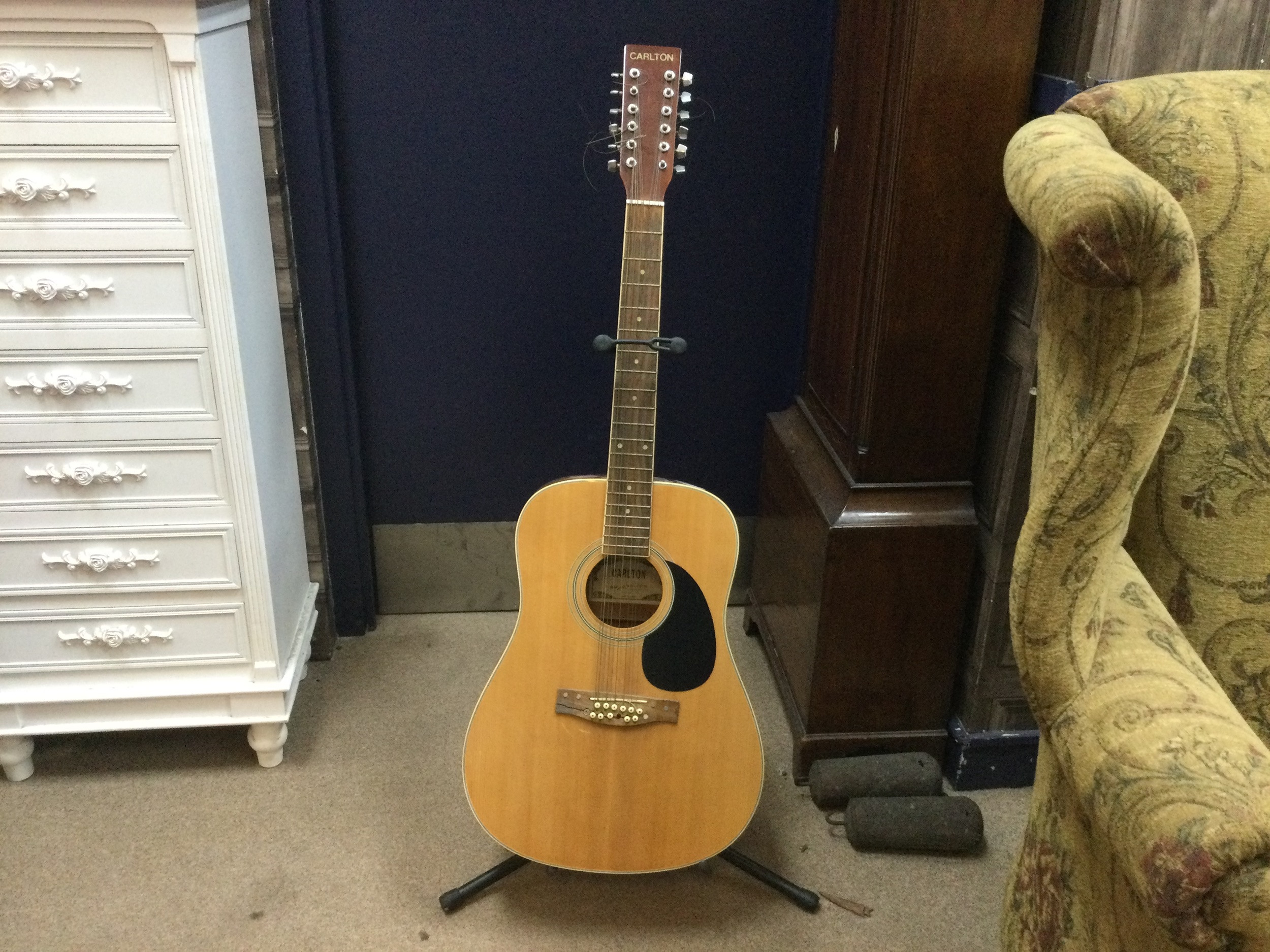 A CARLTON ACOUSTIC GUITAR AND STAND