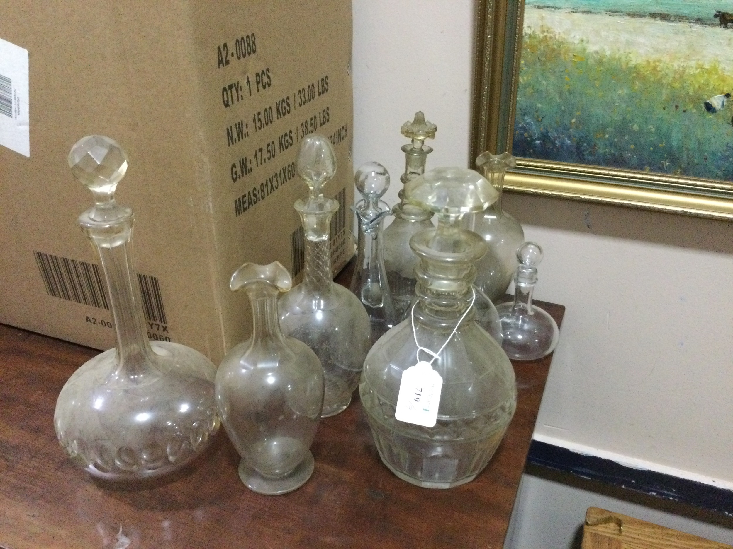 A 19TH CENTURY CUT GLASS DECANTER WITH STOPPER AND OTHER DECANTERS
