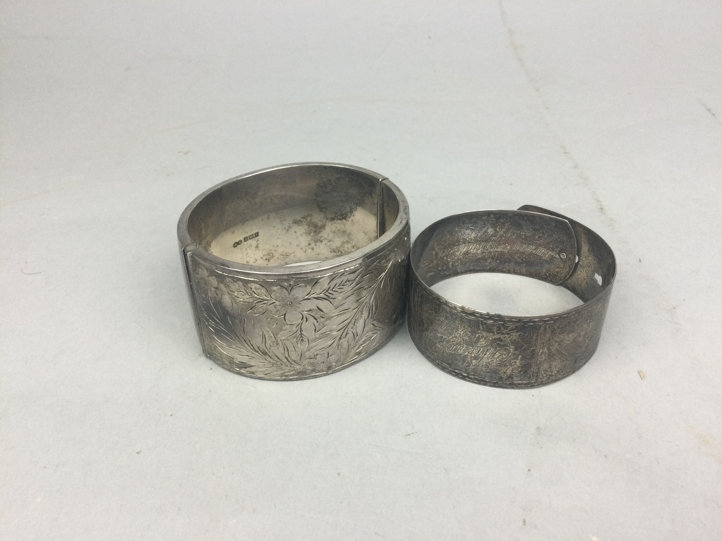 A LOT OF TWO SILVER BANGLES