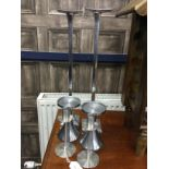THREE PAIRS OF STAINLESS STEEL CANDLESTICKS