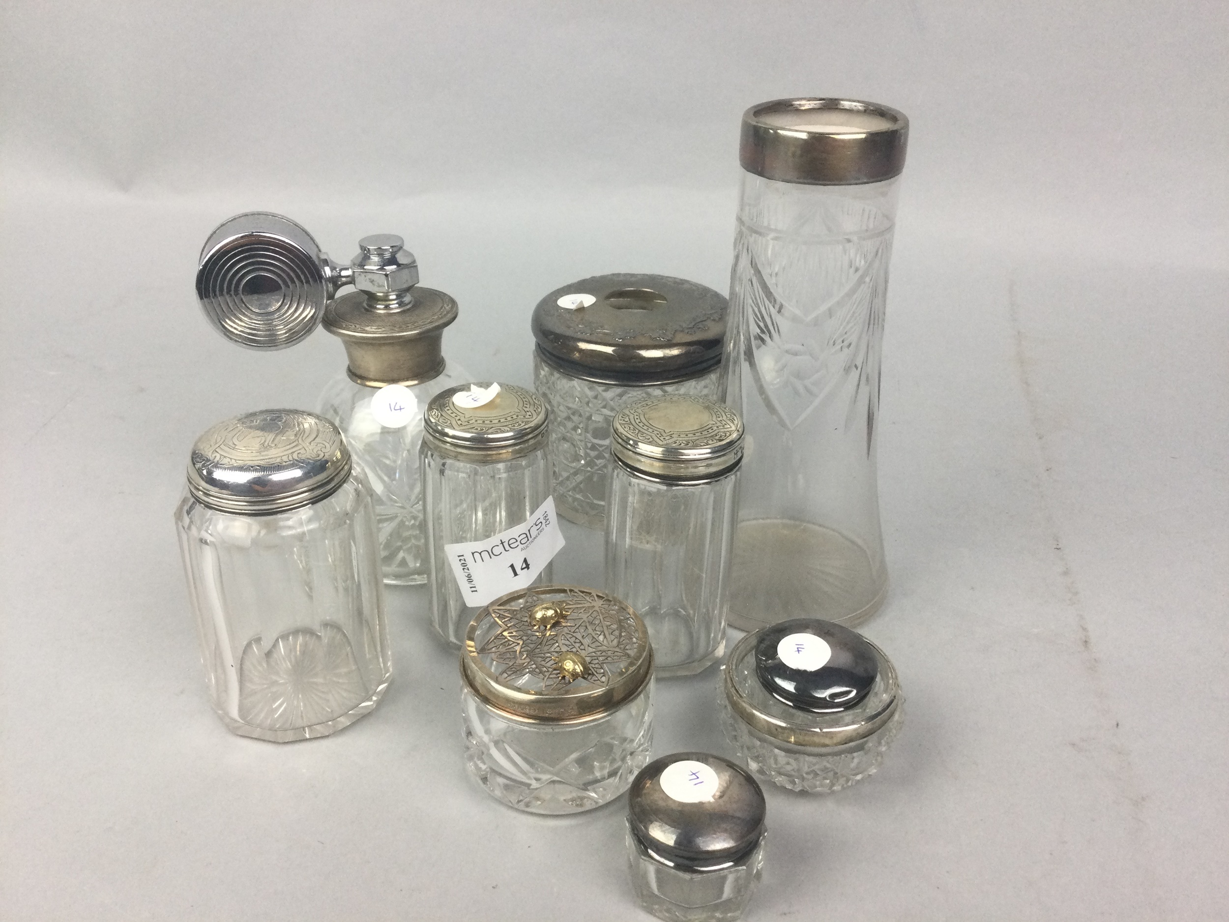 A LOT OF SILVER TOPPED DRESSING TABLE ACCESSORIES