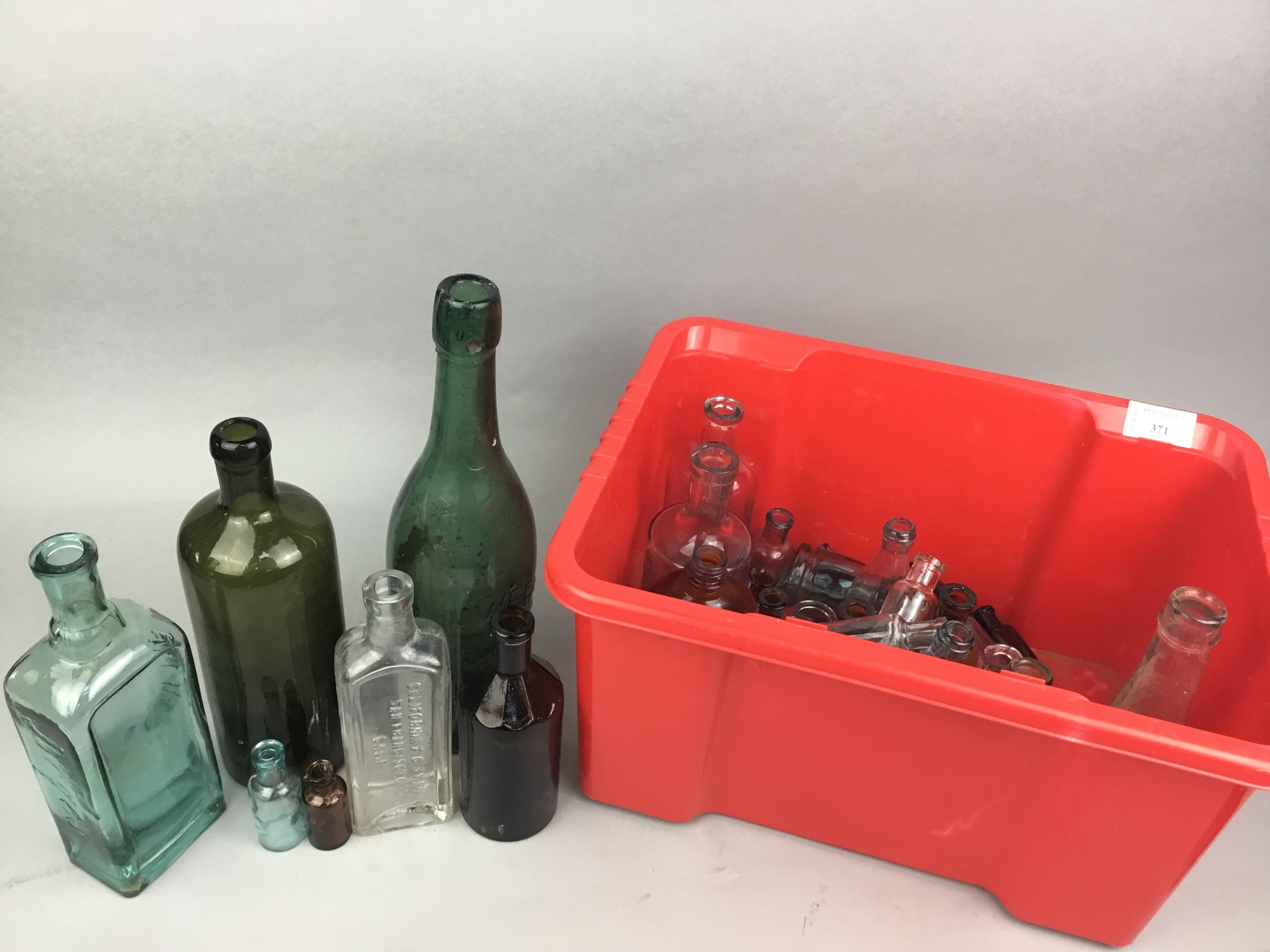 A COLLECTION OF EARLY 20TH CENTURY BEER AND MEDICINE GLASS BOTTLES