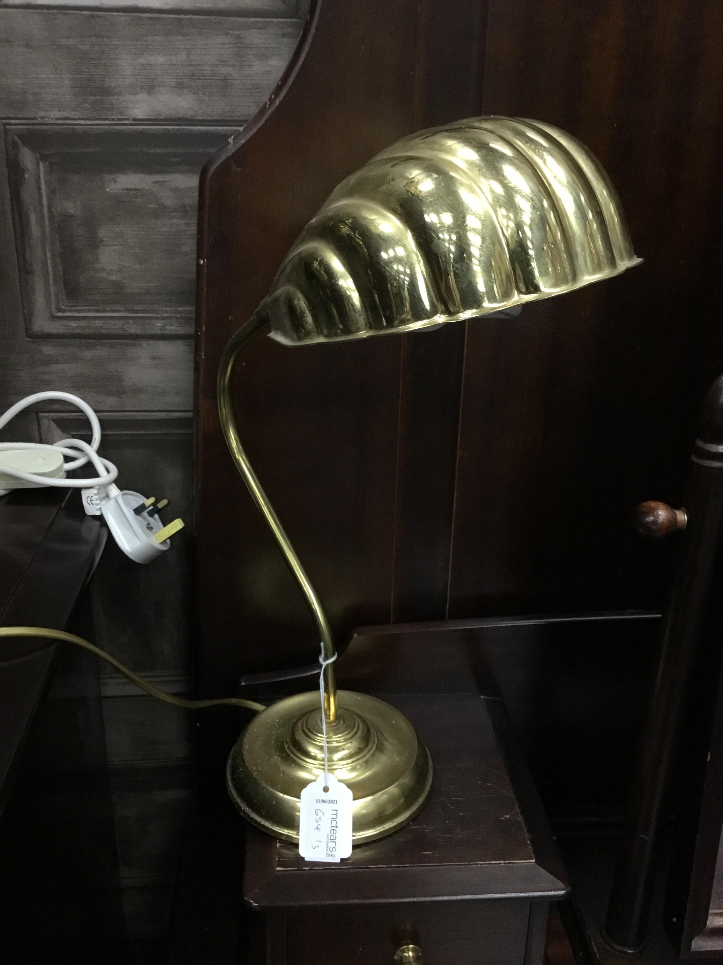 A BRASS TABLE LAMP AND A PAIR OF CONTINENTAL VIENNA STYLE TABLE LAMPS WITH SHADES