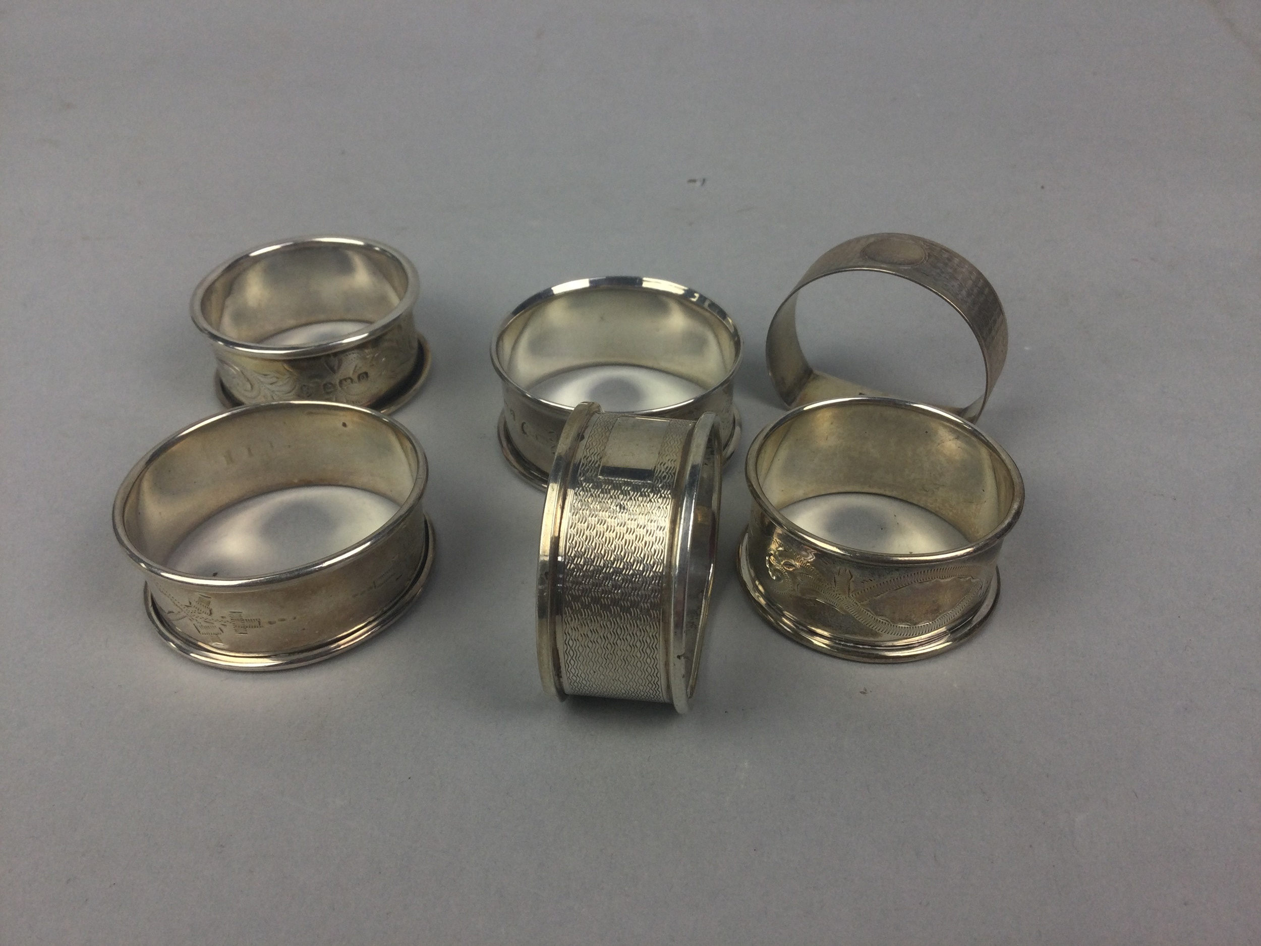 A LOT OF SILVER NAPKIN RINGS