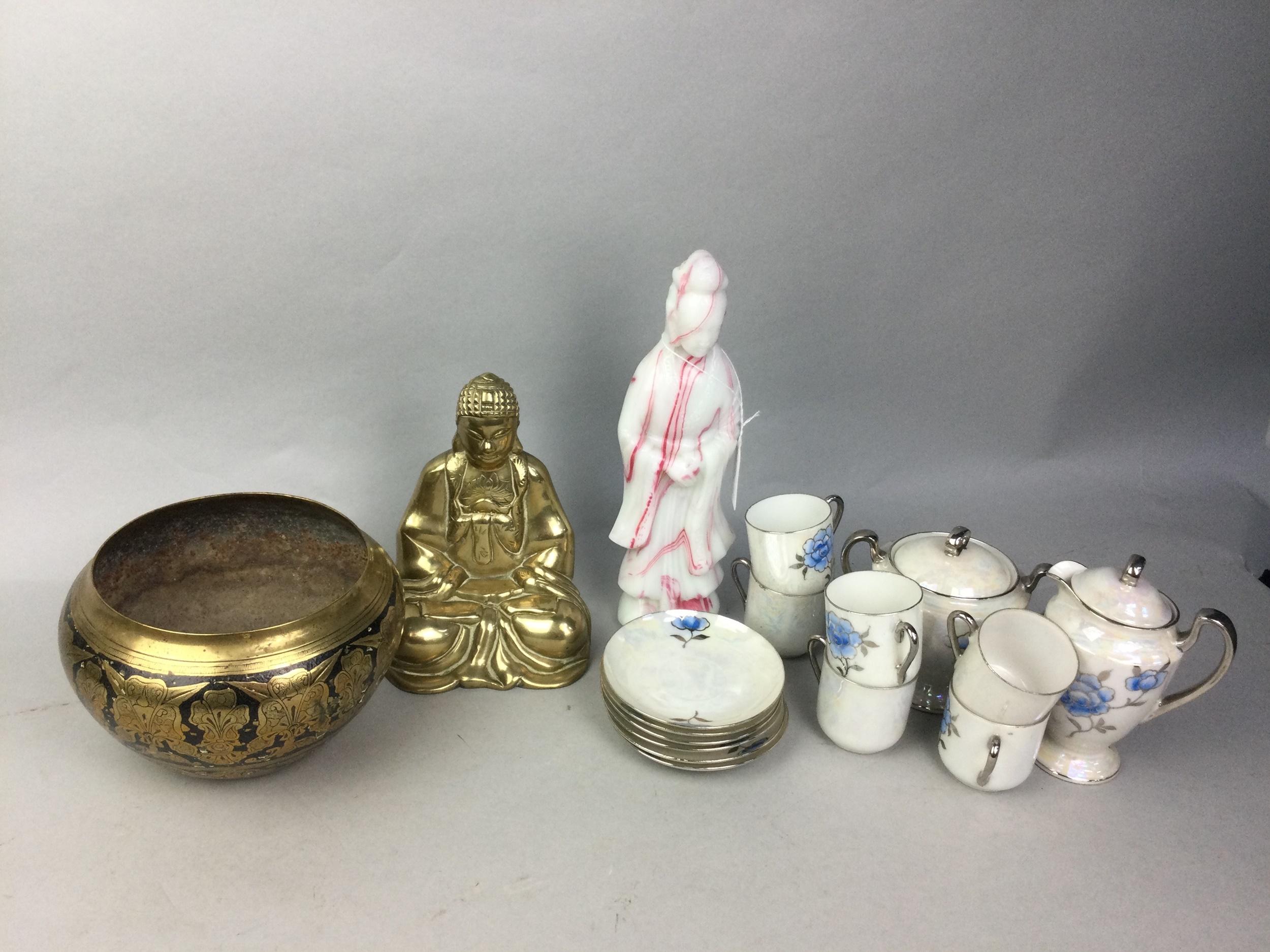A JAPANESE EGG SHELL TEA SERVICE, A BRASS BUDDHA, A BRASS BOWL, A GLASS DEITY AND A GLASS BOWL