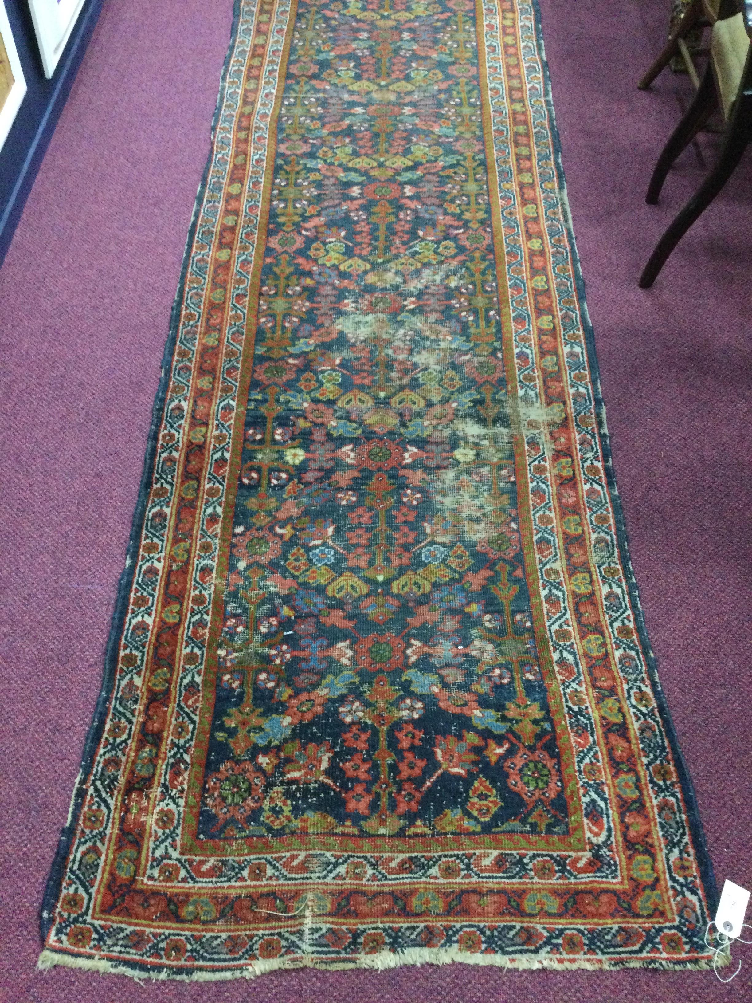 A MIDDLE EASTERN RUG
