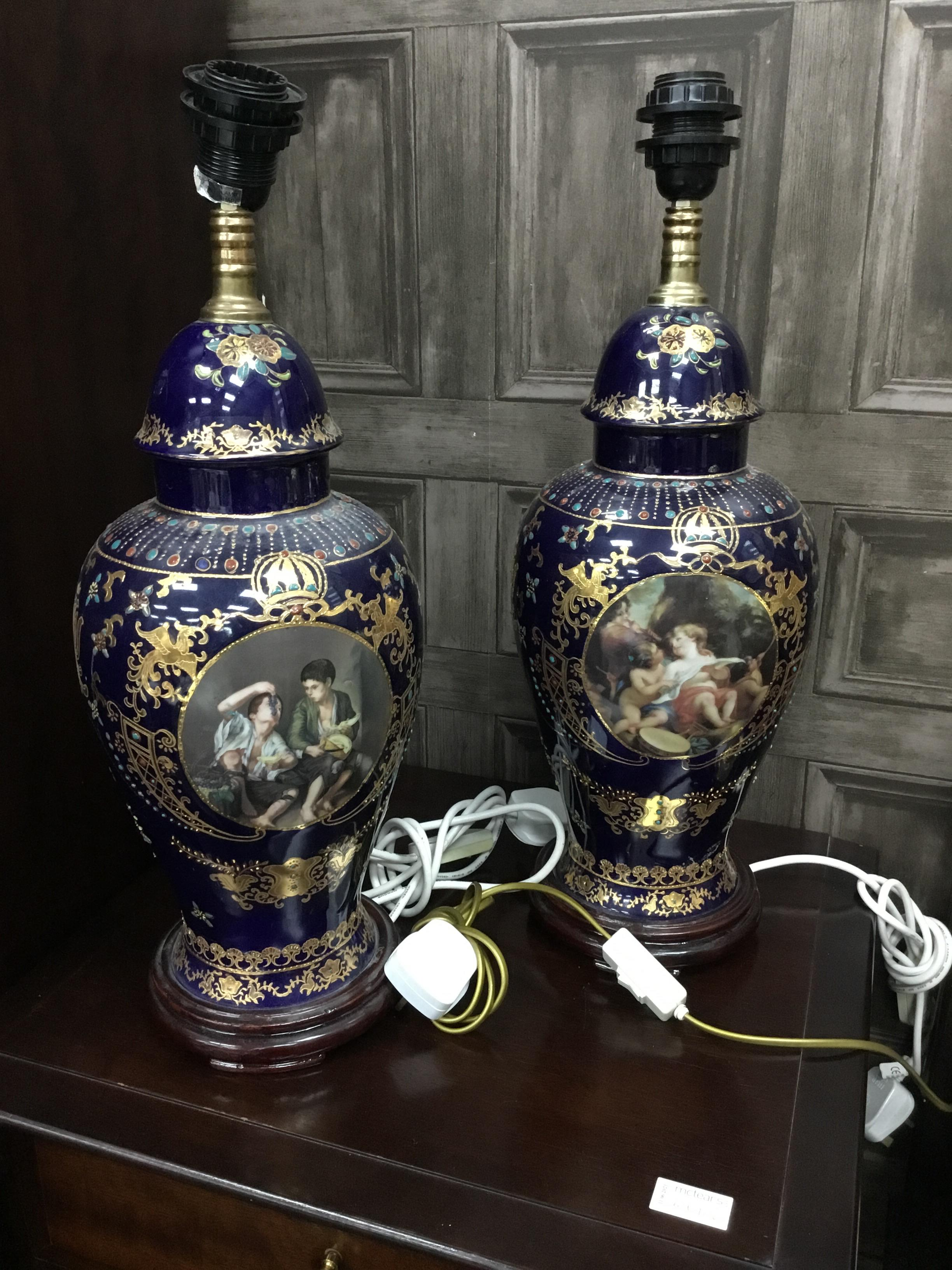 A BRASS TABLE LAMP AND A PAIR OF CONTINENTAL VIENNA STYLE TABLE LAMPS WITH SHADES - Image 2 of 2