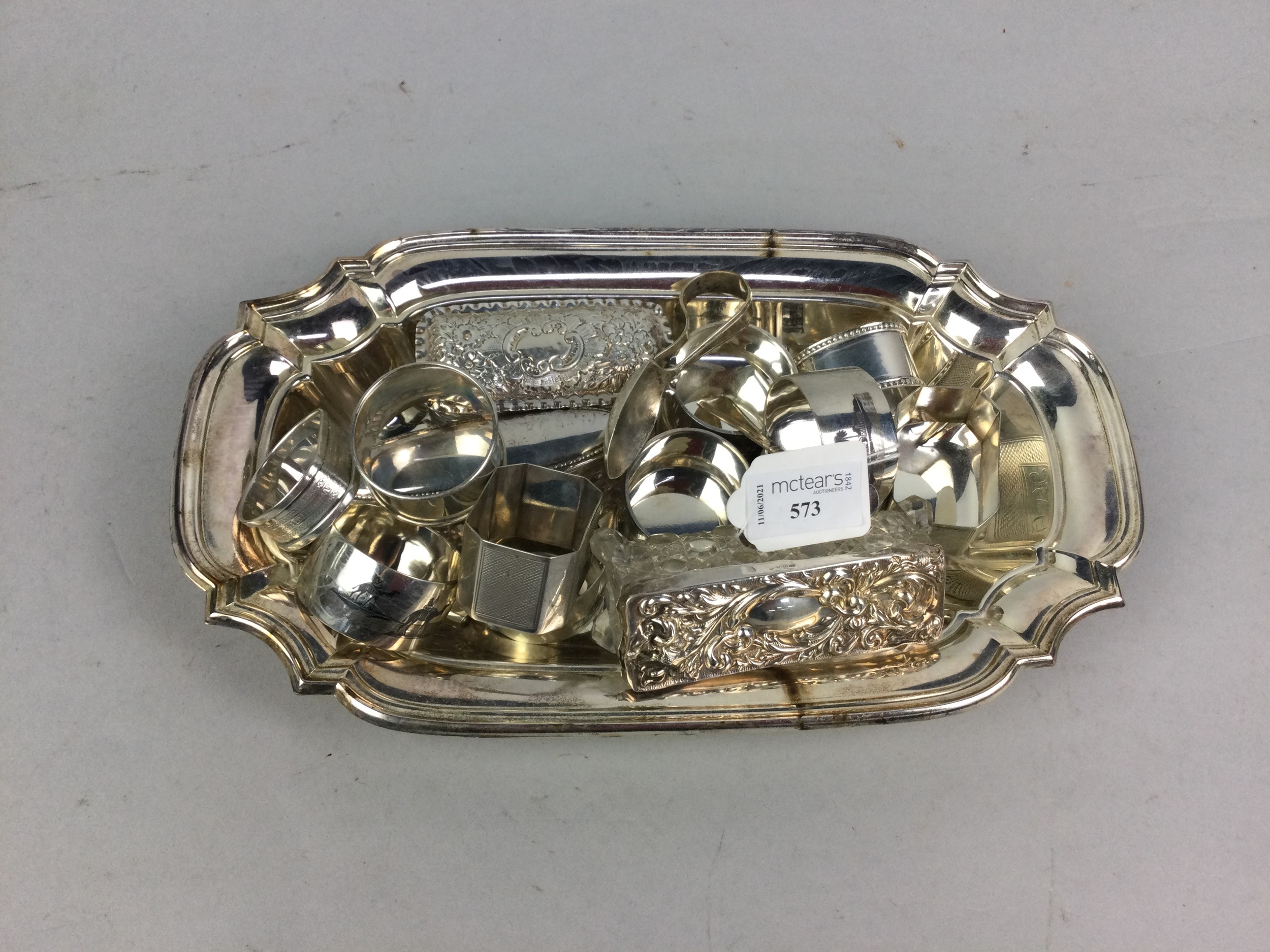 A SET OF SIX NIELLO SILVER NAPKIN RINGS AND OTHER SILVER AND PLATE