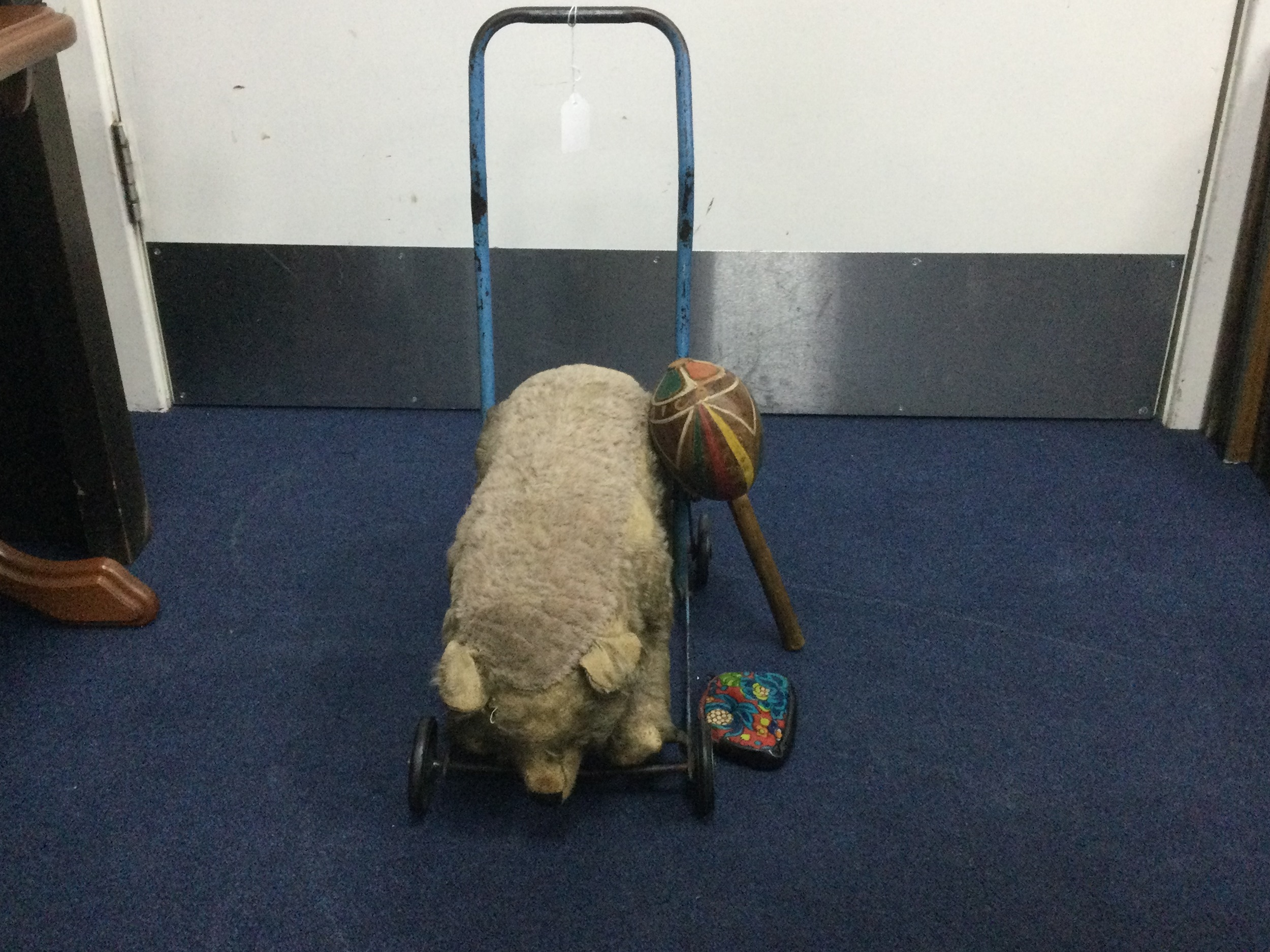 A VINTAGE PUSH ALONG TOY WITH A STUFFED BEAR AND OTHER ITEMS