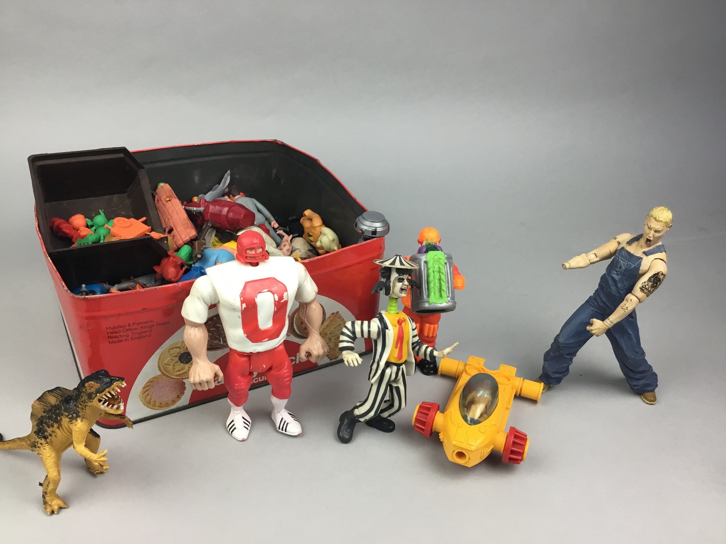 A LOT OF RUBBER AND PLASTIC CHARACTER TOYS
