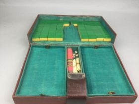 A MID-20TH CENTURY MAH JONG SET, ALONG WITH OTHER CHINESE ITEMS