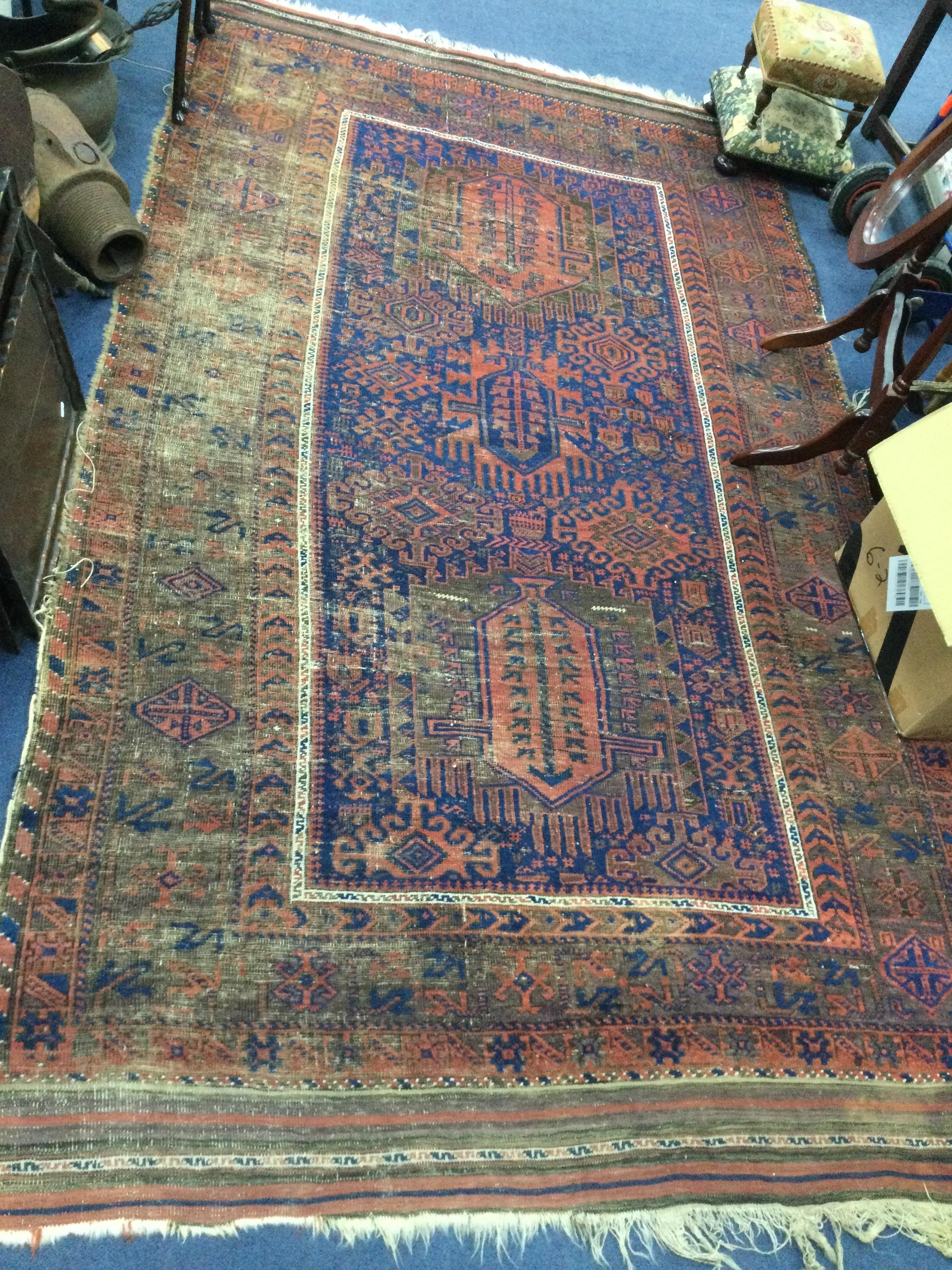 A PERSIAN FRINGED AND BORDERED RUG