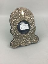 A SILVER MOUNTED WATCH HOLDER FRAME