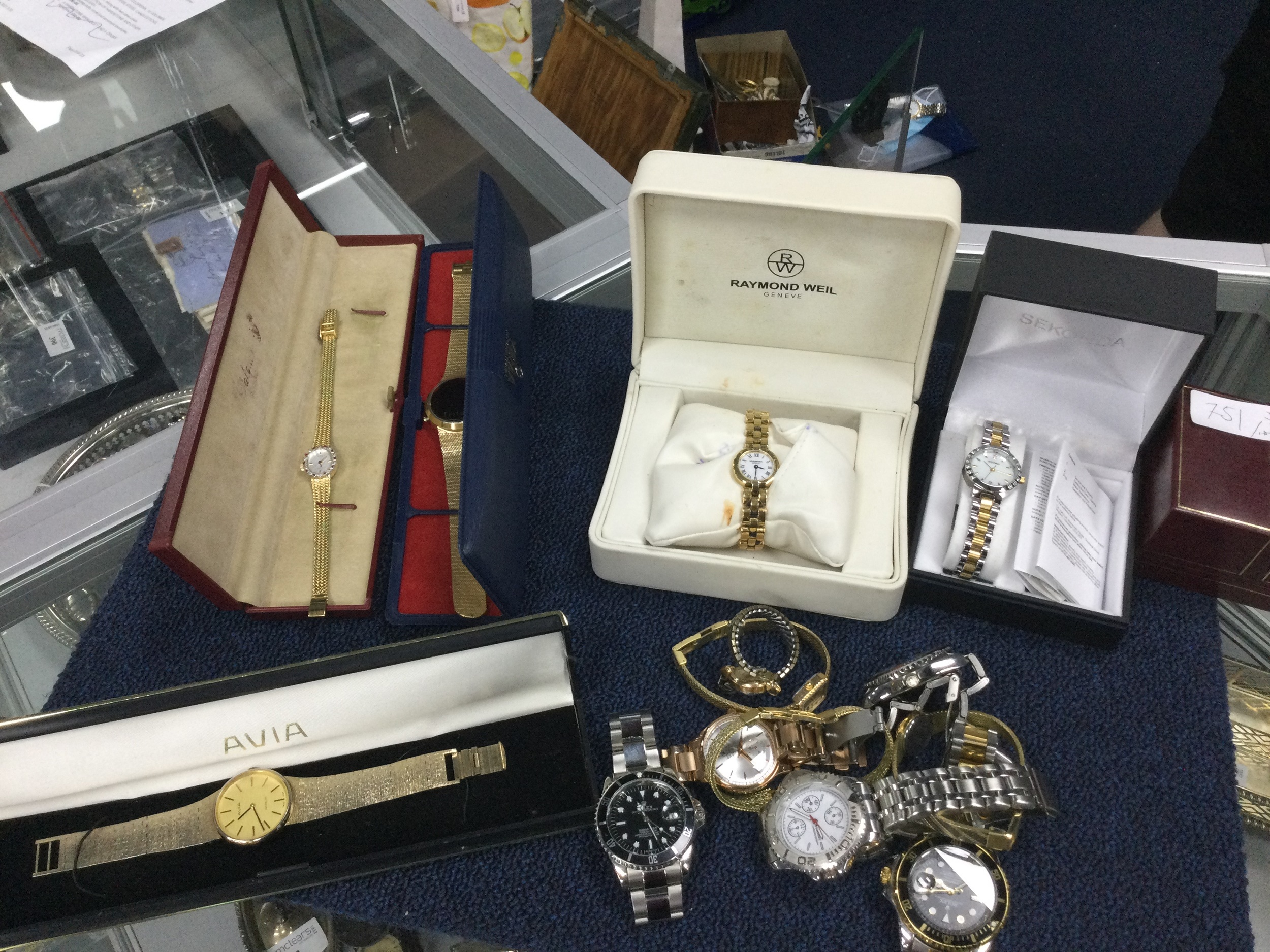 A COLLECTION OF COSTUME WATCHES