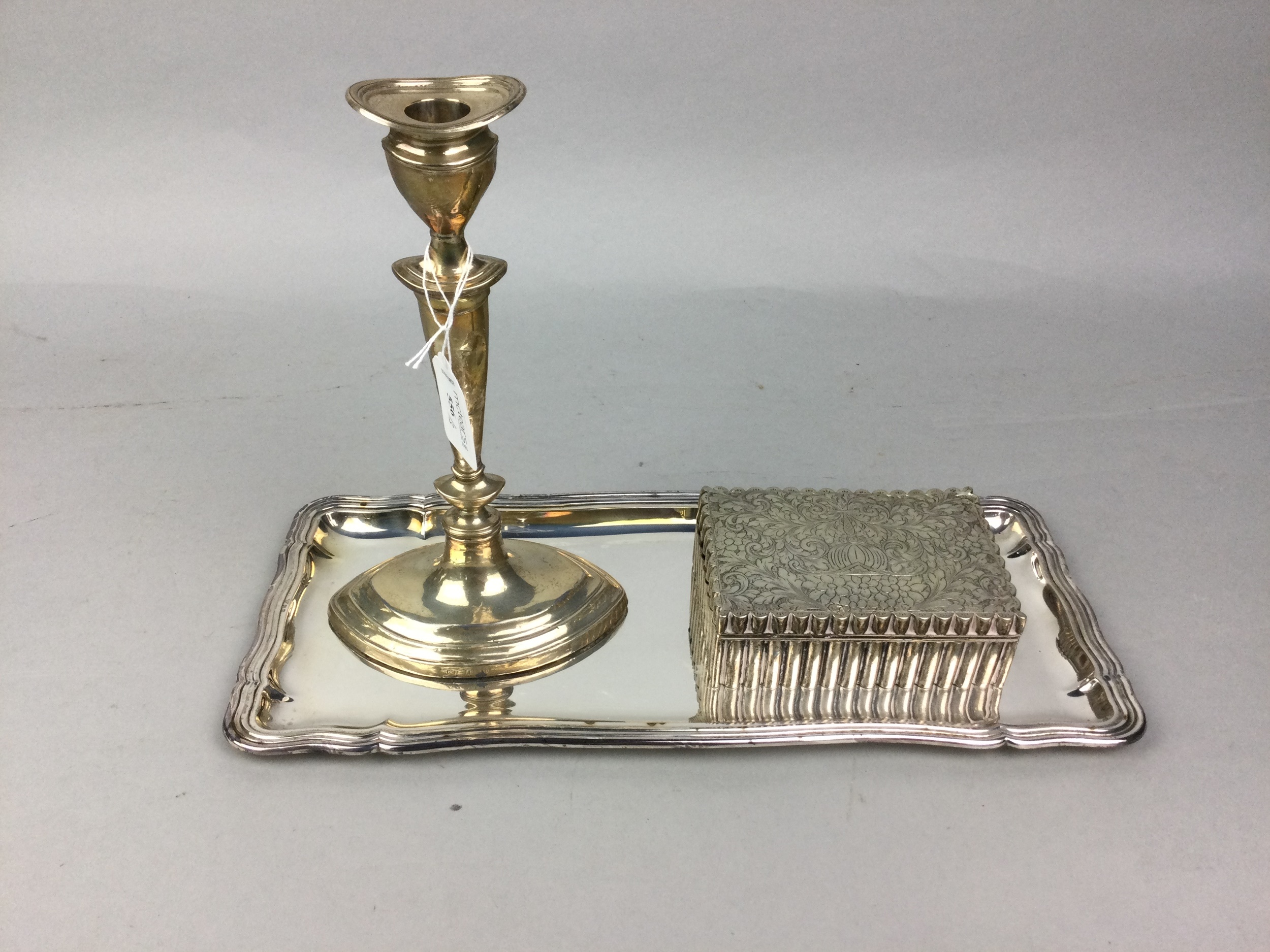 A SILVER TABLE CANDLESTICK, CASKET AND TRAY