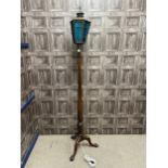 A MAHOGANY BEDPOST FLOOR LAMP