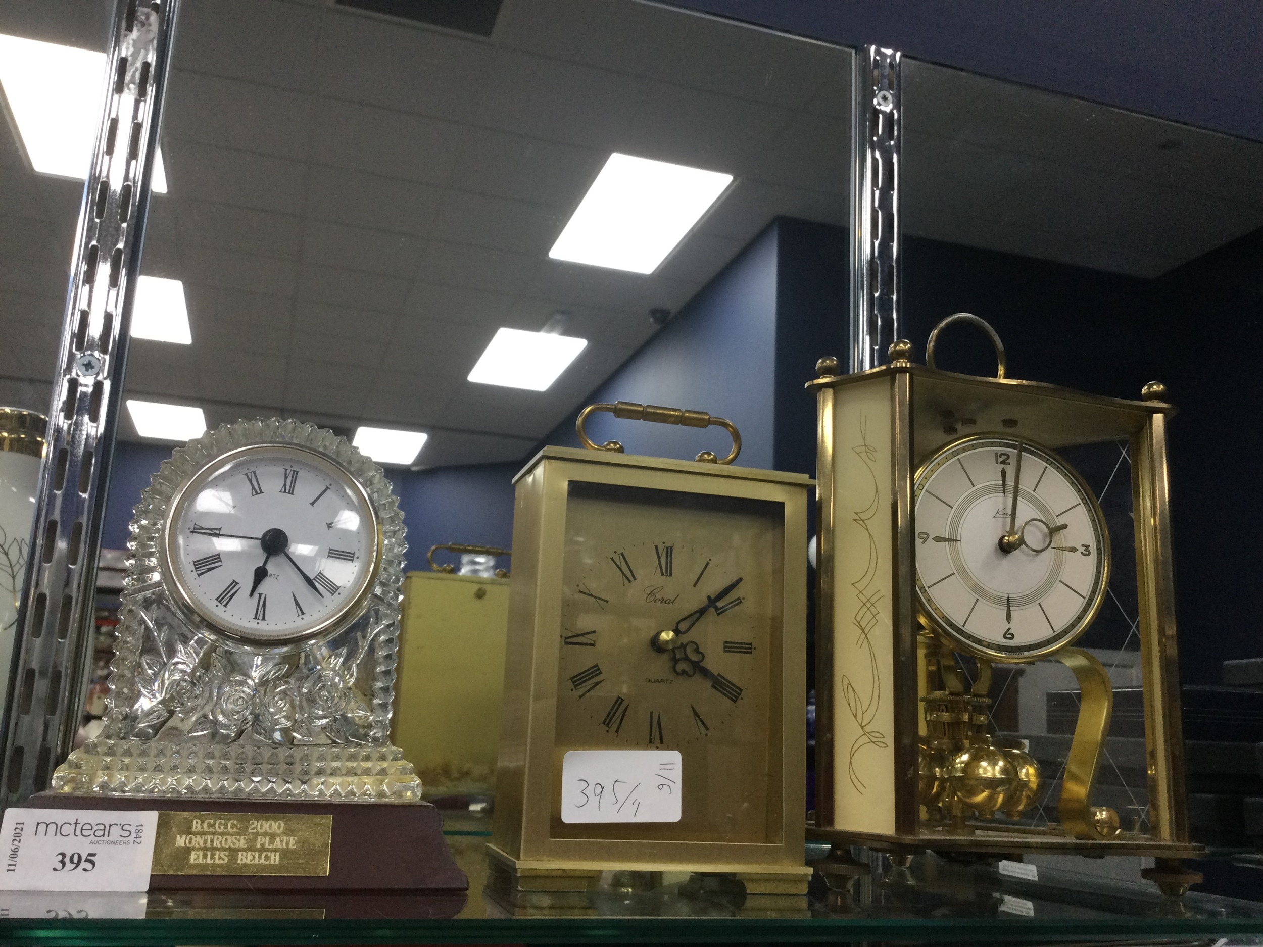 A CUT GLASS MANTLE CLOCK, A CARRIAGE CLOCK AND AN ANNIVERSARY CLOCK