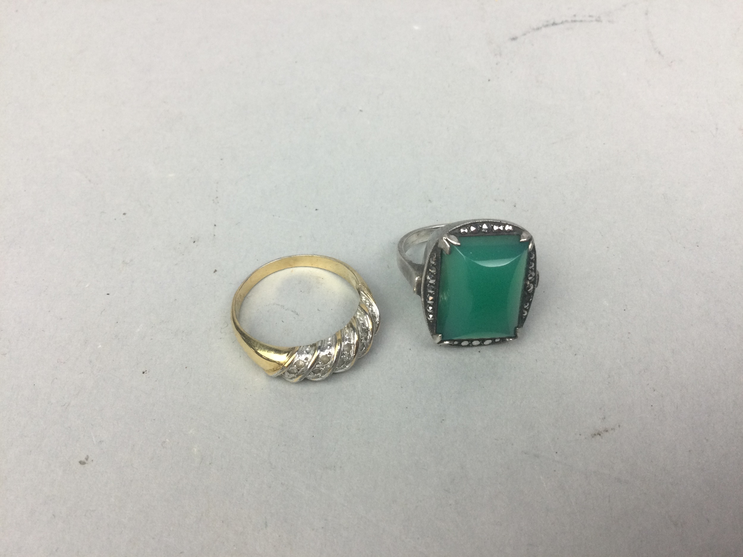 AN ART DECO STYLE RING AND A DRESS RING