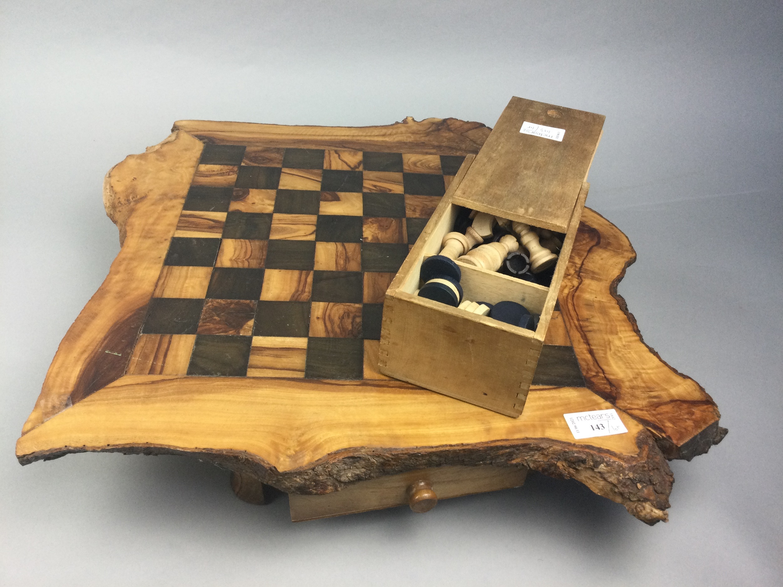 A WOODEN GAMES BOARD WITH CHESS AND DRAUGHTS