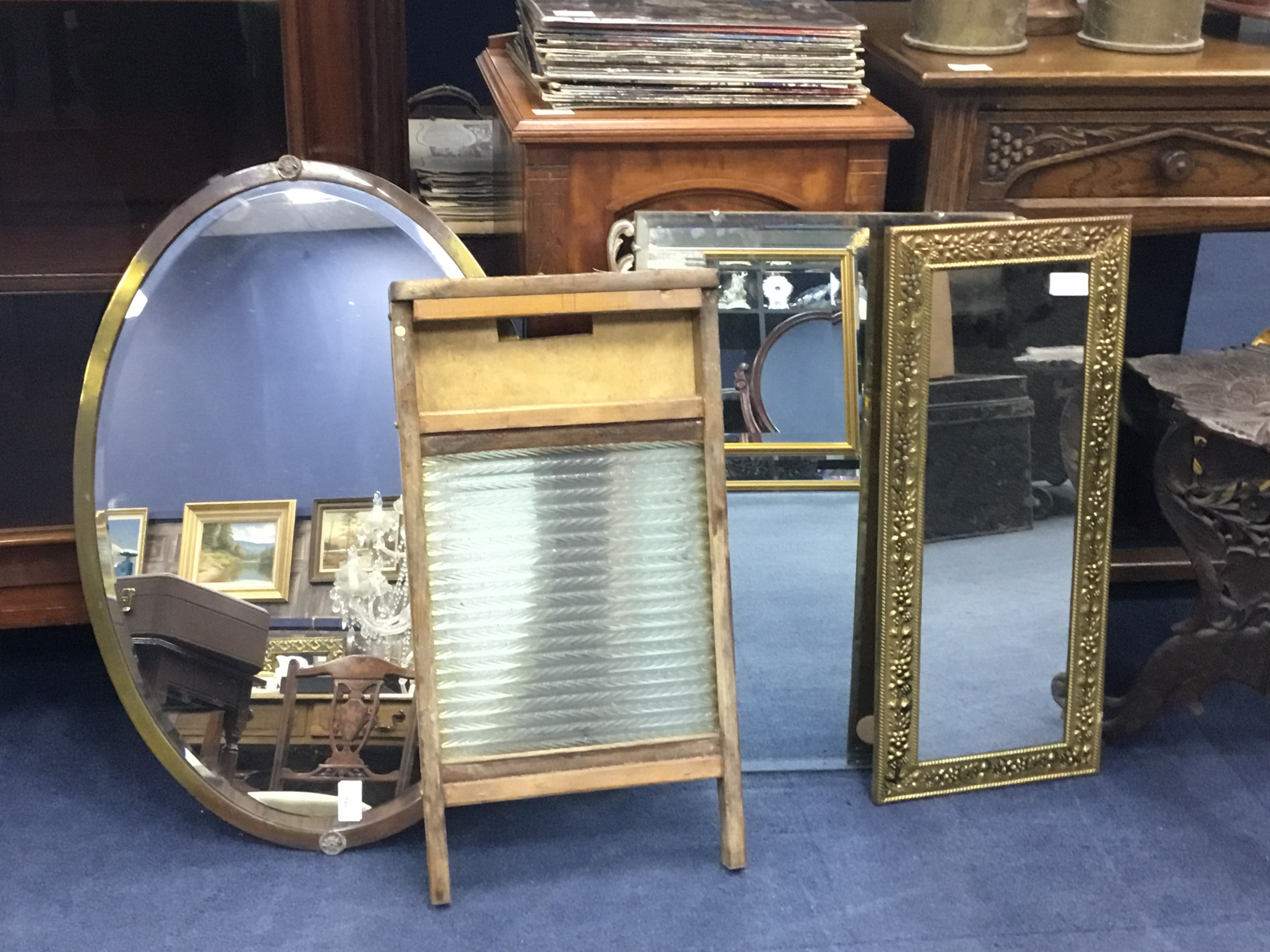 AN BRASS FRAMED BEVELLED WALL MIRROR, TWO OTHER MIRRORS AND A WASHBOARD
