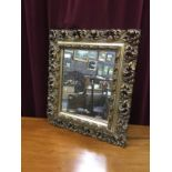 A RECTANGULAR WALL MIRROR AND SIX OTHER MIRRORS