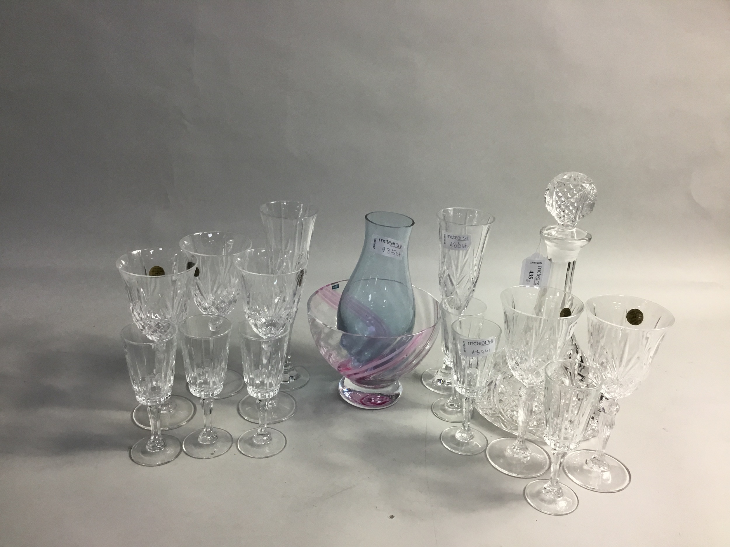A MOULD BLOWN GLASS SHIP'S DECANTER AND OTHER GLASSWARE