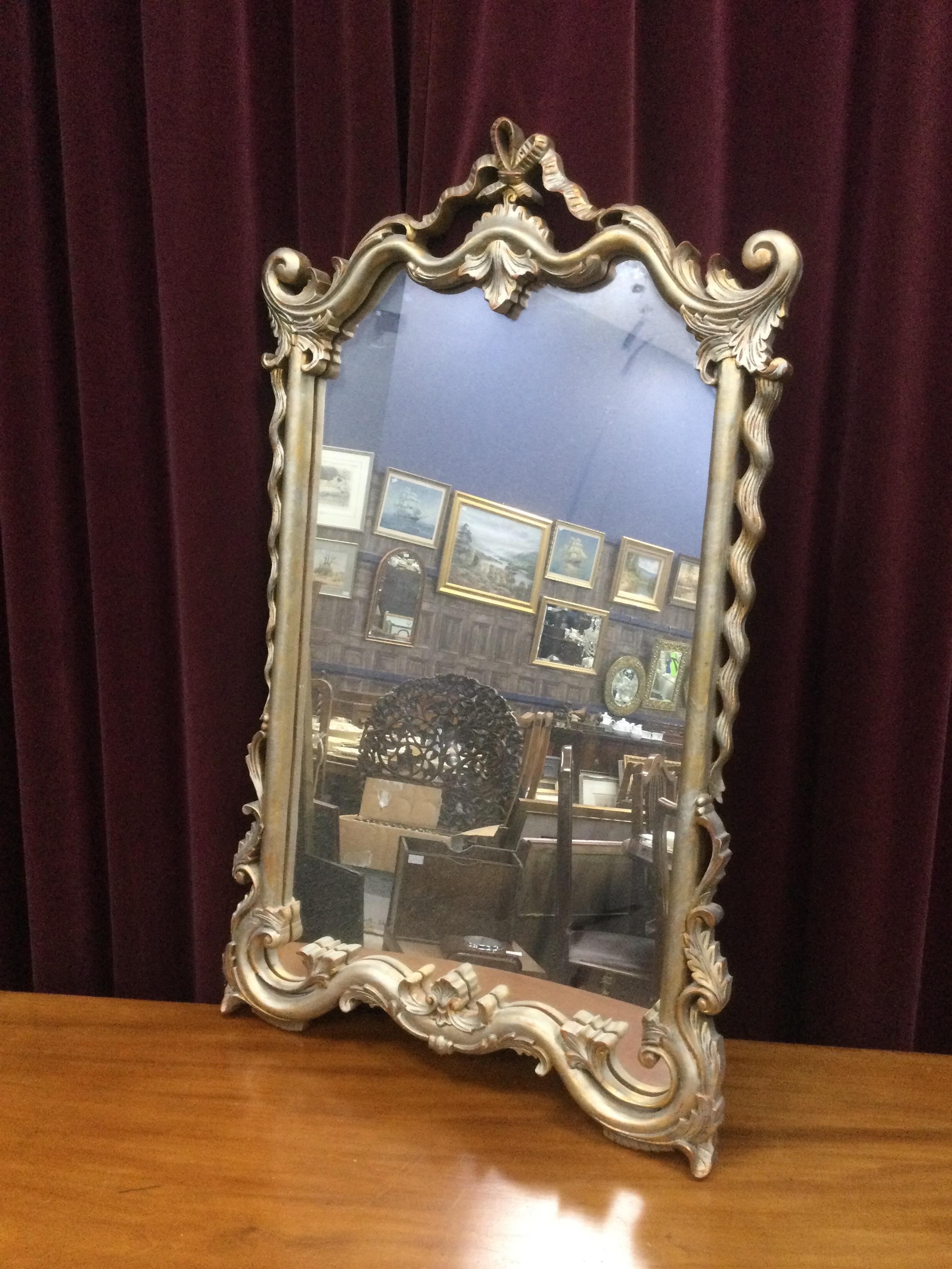 A PAIR OF WALL MIRRORS BY HARRISON & GIL