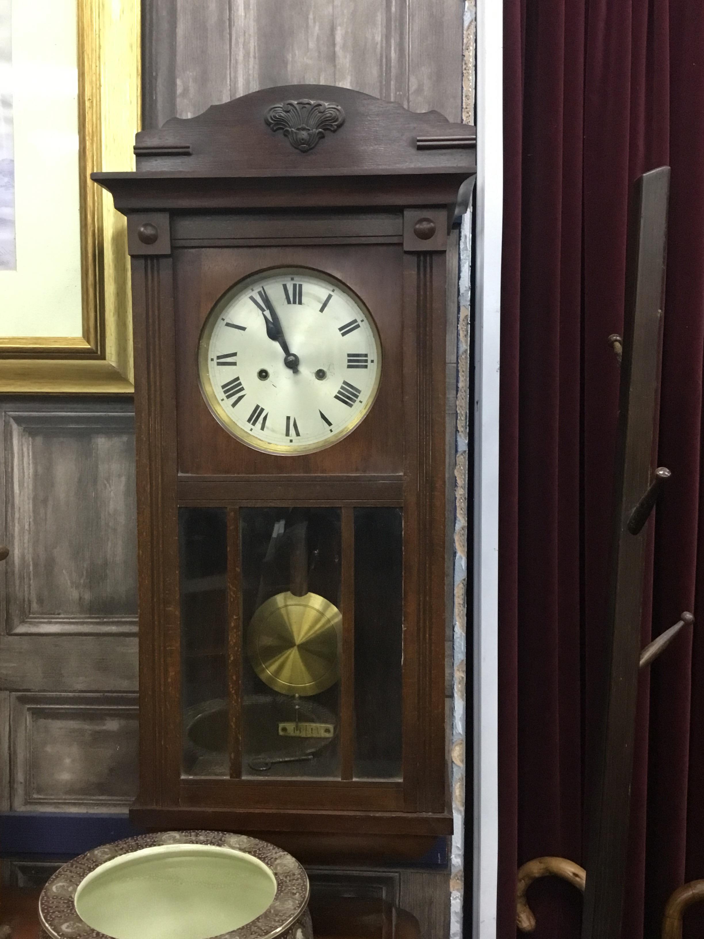 AN EDWARDIAN KITCHEN WALL CLOCK